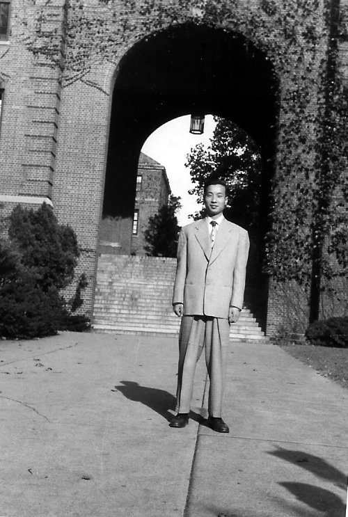 Chi Wang standing in front of Manhattan College, September 1949.  He studied here for one year before transferring to the University of Maryland.